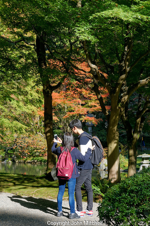 Two Asian students taking a selfie, Nitobe Memorial Garden, University of British Columbia, Vancouver, Canada