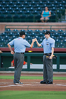 Minor League Umpires Jeff Hamann (left) and Nathan Diederich fist bump before a game between the AZL Brewers and AZL Giants on August 15, 2017 at Scottsdale Stadium in Scottsdale, Arizona. AZL Giants defeated the AZL Brewers 4-3. (Zachary Lucy/Four Seam Images)