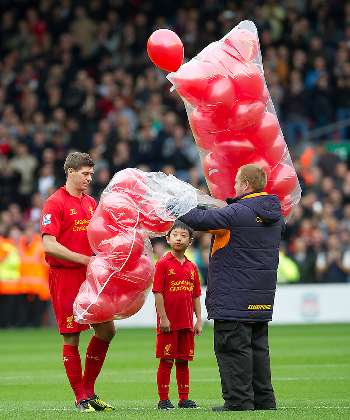 Liverpool's Steven Gerrard releases 96 red ballons, in memory of  the ninetysix who died in the 1989 Hillsborough disaster..Football - Barclays Premiership - Liverpool v Manchester United - Sunday 23rd September 2012 - Anfield - Liverpool..