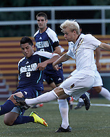 Boston College midfielder Kyle Bekker (10) takes a shot as University of Rhode Island (URI) defender Alan Hernandez (6) defends. Boston College defeated University of Rhode Island, 4-2, at Newton Campus Field, September 25, 2012.