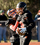 WATERTOWN, CT-112317JS13- Watertown's Thomas Hassan (8) is congratulated by teammate Daniel Graziano (17) after scoring a touchdown during their Thanksgiving Day game Thursday at Watertown High School. <br /> Jim Shannon Republican-American