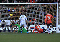 Wes Attkinson of Notts County has his shot deflected into the back of the ne during the Sky Bet League 2 match between Luton Town and Notts County at Kenilworth Road, Luton, England on 30 January 2016. Photo by Liam Smith.