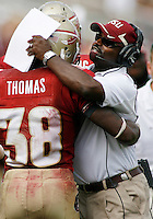 TALLAHASSEE, FL 10/31/09-FSU-NCST FB09 CH34-Florida State's Jermaine Thomas, left, celebrates his 54-yard touchdown run with Running Backs Coach Dexter Carter during first half action against N.C. State, Saturday at Doak Campbell Stadium in Tallahassee. .COLIN HACKLEY PHOTO