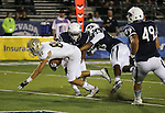 UC Davis receiver Ramon Vargas (80) dives into the end zone past Nevada defenders, from left, Elijah Mitchell (28), Kendall Johnson (26) and Jordan Dobrich (49) during the second half of an NCAA college football game in Reno, Nev. on Thursday, Sept. 3, 2015. Nevada won 31-17. (AP Photo/Cathleen Allison)