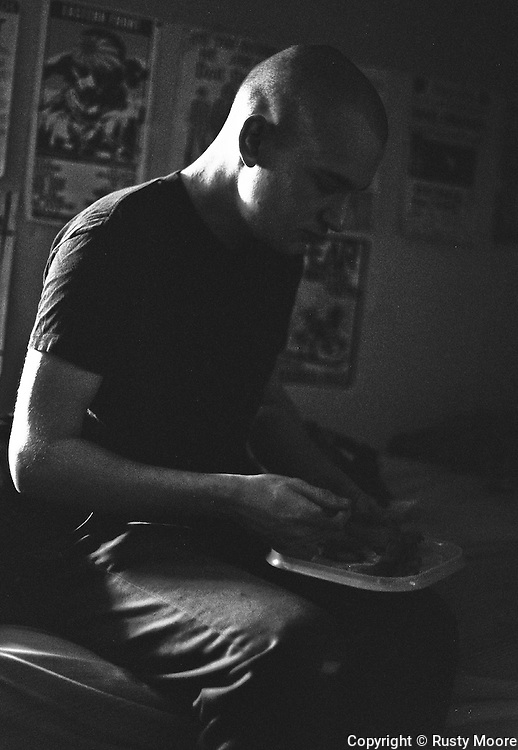 Ian MacKaye of Minor Threat having lunch in his bedroom at Dischord House, Arlington VA, spring 1982.