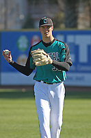 Coastal Carolina Chanticleers pitcher Tyler Poole #33 throwing in the outfield before a game against the North Carolina State Wolfpack at BB&T Coastal Field on February 26, 2012 in Myrtle Beach, SC.  Coastal Carolina defeated N.C. State 3-2. (Robert Gurganus/Four Seam Images)
