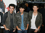 """HOLLYWOOD, CA. - April 14: Kevin Jonas, Joe Jonas and Nick Jonas of The Jonas Brothers arrive at the premiere of Warner Bros. """"17 Again"""" held at Grauman's Chinese Theatre on April 14, 2009 in Hollywood, California."""