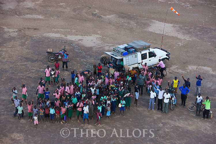 Kenya, Rift Valley, Lake Bogoria, many local people, mainly children waving at me while I am flying with my paramotor