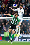 Darko Brasanac of Real Betis competes for the ball with Sergio Ramos of Real Madrid during the match of Spanish La Liga between Real Madrid and Real Betis at  Santiago Bernabeu Stadium in Madrid, Spain. March 12, 2017. (ALTERPHOTOS / Rodrigo Jimenez)