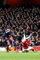 Collin Quaner of Huddersfield Town has his shot blocked during the Premier League match between Arsenal and Huddersfield Town at the Emirates Stadium, London, England on 29 November 2017. Photo by Carlton Myrie / PRiME Media Images.