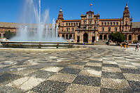 Water fountain and horsedrawn cart in the Plaza de Espana, Seville, Andalusia, Spain.