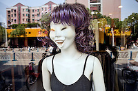 A strange-looking mannequin displays women's clothing for sale in a shop window in Jiangning, Nanjing, Jiangsu, China.