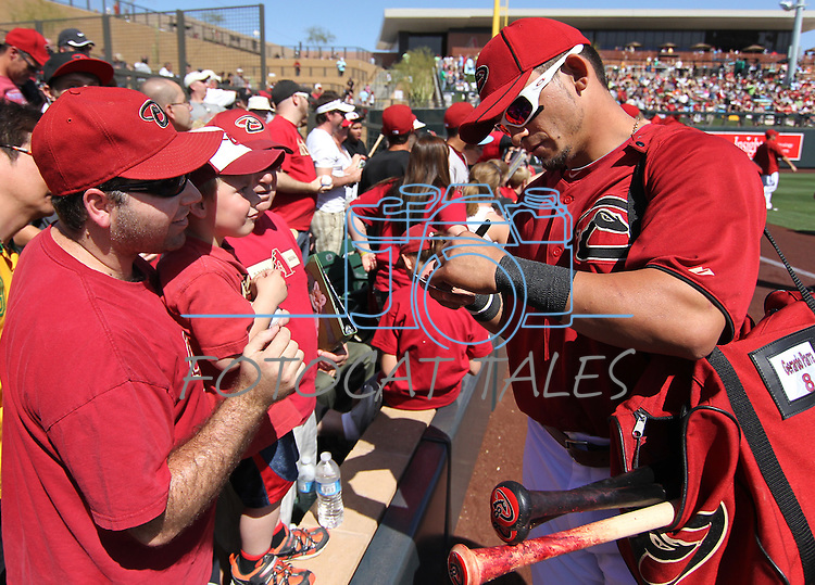 Diamondbacks outfielder Gerardo Parra signs autographs before a Cactus League preseason game between the San Francisco Giants and the Arizona Diamondbacks in Scottsdale, Ariz., on Sunday, March 4, 2012. .Photo by Cathleen Allison