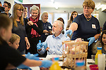 © Joel Goodman - 07973 332324 . 24/09/2016 . Liverpool , UK . JEREMY CORBYN makes pizza breads during a visit to Beaconsfield Community House in Birkenhead , following his victory declaration . The centre provides clothes and food that would otherwise be destined for waste from supermarkets , to local residents in need . Photo credit : Joel Goodman