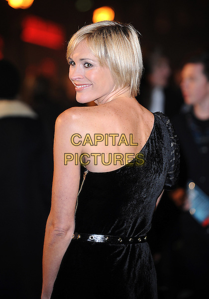 "JENNI FALCONER.The World Premiere of ""Sherlock Holmes"", Empire cinema Leicester Square, London, England..December 14th 2009 .arrivals half length black velvet dress one shoulder looking over.AP/BEL.©Tom Belcher/Capital Pictures."