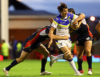 PICTURE BY ALEX WHITEHEAD/SWPIX.COM - Rugby League - Super League Play-Off - Warrington Wolves vs St Helens - The Halliwell Jones Stadium, Warrington, England - 15/09/12 - Warrington's Stefan Ratchford is tackled by St Helens' Gary Wheeler and Jonny Lomax.