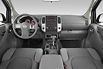 Straight dashboard view of a 2009 Nissan Frontier Crew Cab SE.