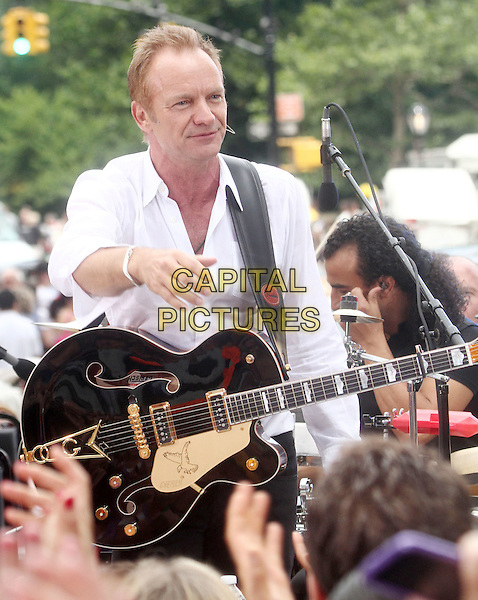 "STING (Gordon Matthew Thomas Sumner).Sting Performs On CBS' ""The Early Show"" held at the CBS Early Show Studio Plaza, New York, NY, USA..July 15th, 2010.stage concert live gig performance music half length white shirt hand arm guitar.CAP/ADM/AC.©Alex Cole/AdMedia/Capital Pictures."