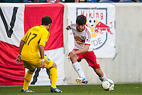 Juninho (8) of the New York Red Bulls passes the ball. The New York Red Bulls and the Columbus Crew played to a 2-2 tie during a Major League Soccer (MLS) match at Red Bull Arena in Harrison, NJ, on May 26, 2013.