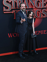 "28 June 2019 - Santa Monica, California - David Harbour, Winona Ryder. ""Stranger Things 3"" Los Angeles Premiere held at Santa Monica High School. Photo Credit: Birdie Thompson/AdMedia"