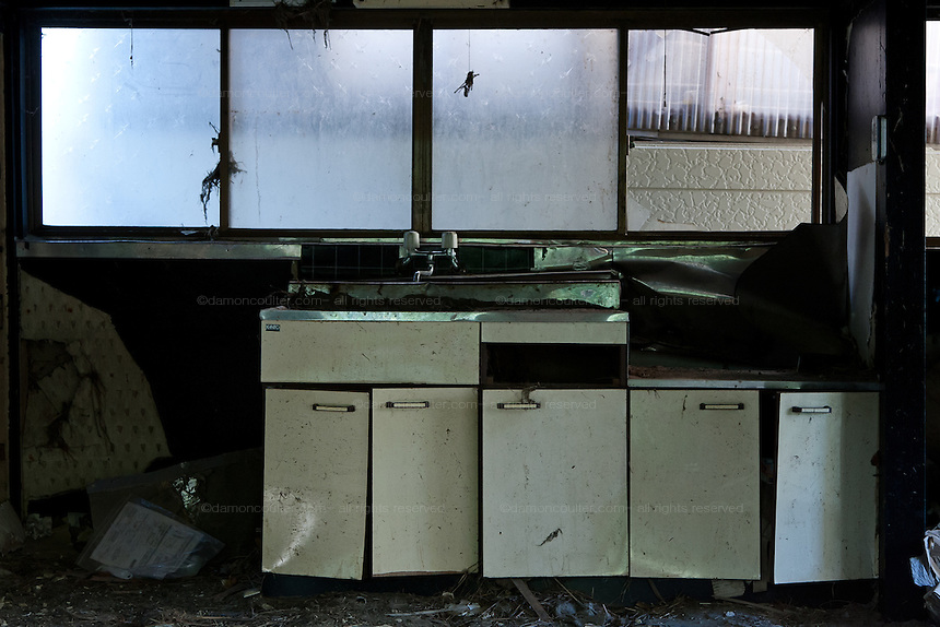 A damaged kitchen in the town of Tomioka, Futaba District of Fukushima, Japan. Monday April 29th 2013. The town was evacuated on March 12th after the March 11th 2011 earthquake and tsunami cause meltdowns at the nearby Fukushima Daichi nuclear power station. It lies well within the 20 kms exclusion zone though parts of the town were opened in spring 2013 again to allow locals to visit their property during daylight hours.