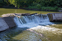 Cottonwood Falls Dam in Cottonwood Kansas was built of cut limestone which was later covered with concrete.