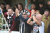 Grimsby Town fans celebrate at the final whistle during the FA Trophy Semi Final first leg match between Bognor Regis and Grimsby Town at Nyewood Lane, Bognor Regis, England on 12 March 2016. Photo by Paul Paxford/PRiME Media Images.