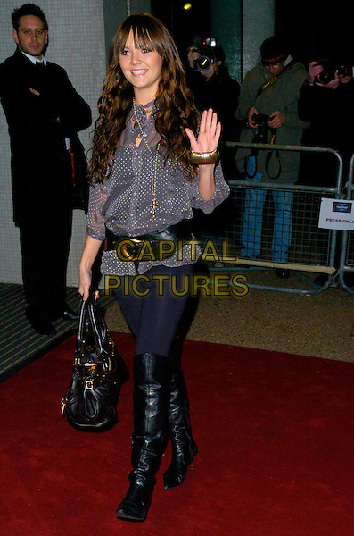 "CHARLIE BROOKS.Arrives at ""An Audience With Take That"".at The London Television Studios,.London, England, December 2nd 2006..full length grey polka dot top leggings black bag boots fringe belt hand waving.CAP/CAN.©Can Nguyen/Capital Pictures"