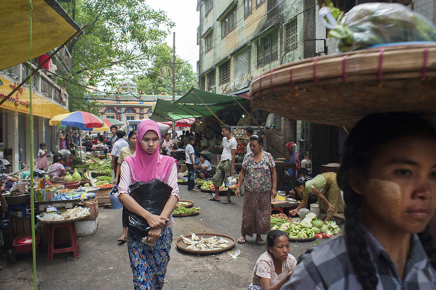 A Muslim woman (left) at a market in Yangon.