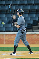 Russell Clark (35) of the Cincinnati Bearcats at bat against the Wake Forest Demon Deacons at Wake Forest Baseball Park on February 21, 2014 in Winston-Salem, North Carolina.  The Bearcats defeated the Demon Deacons 5-0.  (Brian Westerholt/Four Seam Images)