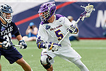 Connor Fields (#5) attacks as Yale defeats UAlbany 20-11 in the NCAAA semifinal game at Gillette Stadium, May 26.