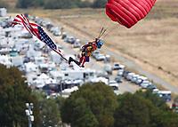 Jul 29, 2018; Sonoma, CA, USA; A skydiver parachute man parachutes in prior to the NHRA Sonoma Nationals at Sonoma Raceway. Mandatory Credit: Mark J. Rebilas-USA TODAY Sports
