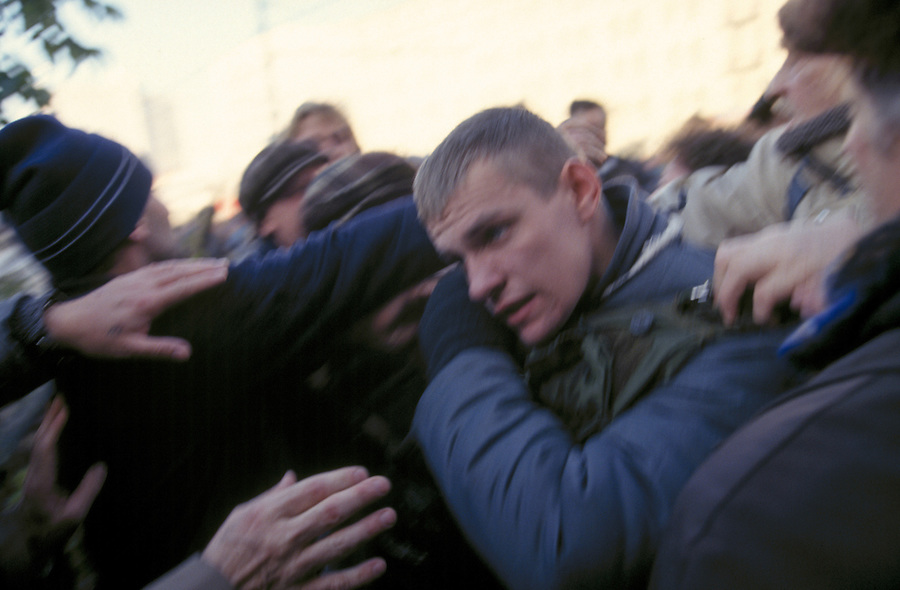 Moscow, Russia, 03/10/1993..Demonstrators beat and strip a pro-Government militiaman of his weapons and protective clothing after they broke through police lines preventing them marching to the Russian Parliament, which rebel Communist and nationalist deputies, led by Vice-President Alexander Rutskoi, had occupied after President Boris Yeltsin dissolved the parliament..