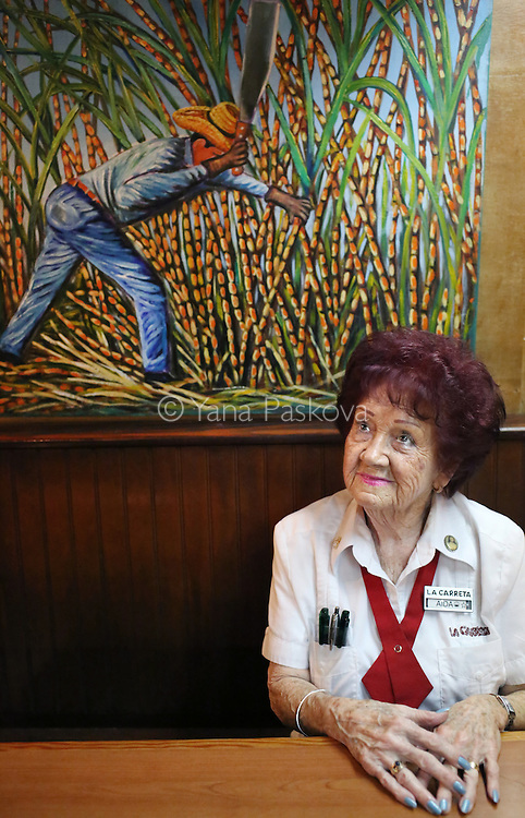 MIAMI, FL - MARCH 11: Aida Andreu, a Republican in Miami, poses for a portrait in the restaurant where she works, La Carreta, on March 11, 2016. She says she would like to vote for U.S. Presidential candidate Donald Trump (R-NY) in the state's Tuesday primary because she believes he is capable of changing America for the better. As far as Ted Cruz (R-TX) or Marco Rubio (R-FL), she says she does not believe either to be ready for a presidency, and is not influenced by their Cuban roots. (Photo by Yana Paskova/For The Washington Post)