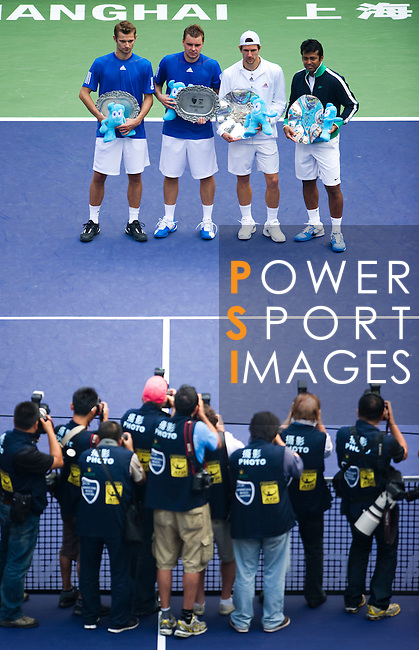 SHANGHAI, CHINA - OCTOBER 17:  Jurgern Melzer of Austria and Leander Paes of India, Mariusz Fyrstenberg and Marcin Matkowski of Poland pose for photographers with trophies after their doubles final during day seven of the 2010 Shanghai Rolex Masters at the Shanghai Qi Zhong Tennis Center on October 17, 2010 in Shanghai, China.  (Photo by Victor Fraile/The Power of Sport Images) *** Local Caption *** Jurgern Melzer; Leander Paes; Mariusz Fyrstenberg; Marcin Matkowski