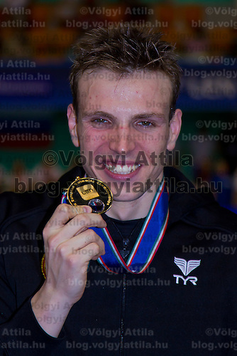 Paul Biedermann of Germany celebrates his victory in the Men's 200m Freestyle final of the 31th European Swimming Championships in Debrecen, Hungary on May 23, 2012. ATTILA VOLGYI