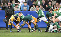 Ireland scrum half Kris Greene puts Australian winger Patrick McCabe under pressure during the Division A U19 World Championship clash at Ravenhill.