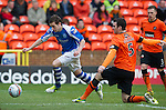 Dundee Utd v St Johnstone..26.12.12      SPL.Peter Pawlet fires the ball into Brian McLean which went in the net for an own goal.Picture by Graeme Hart..Copyright Perthshire Picture Agency.Tel: 01738 623350  Mobile: 07990 594431