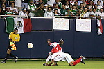 21 June 2007:  Guadeloupe's Alain Vertot (6) lands awkwardly atop Mexico's Alberto Medina (7) following a challenge.  Vertot was called for a foul on the play. The National Team of Mexico defeated Guadeloupe 1-0  in a CONCACAF Gold Cup Semifinal match at Soldier Field in Chicago, Illinois.