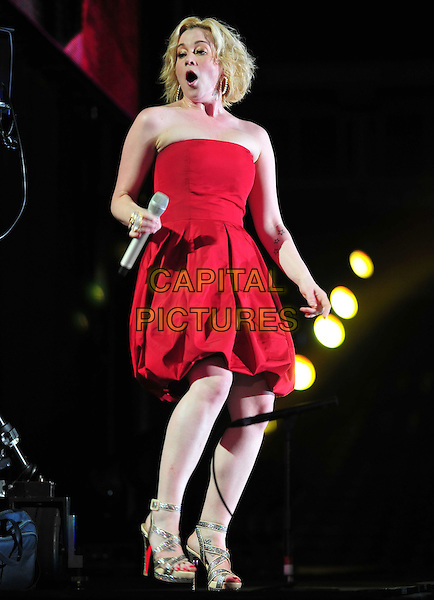 KELLIE PICKLER .2010 CMA Music Festival Nightly Concert held at LP Field, Nashville, Tennessee, USA..June 13th, 2010.stage concert live gig performance music full length red strapless dress mouth open funny face .CAP/ADM/LF.©Laura Farr/AdMedia/Capital Pictures.