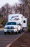 Dodge Ram dually towing fifth wheel travel trailer with slide out.