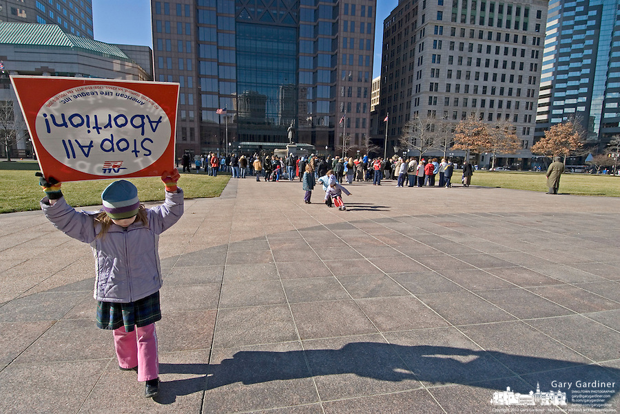 A child walks with an anti-abortion placard at a Pro-Life rally at the Statehouse in Columbus, Ohio, Monday, Nov. 23, 2006 on the 33rd anniversary of the Supreme Court Roe v. Wade decision.<br />