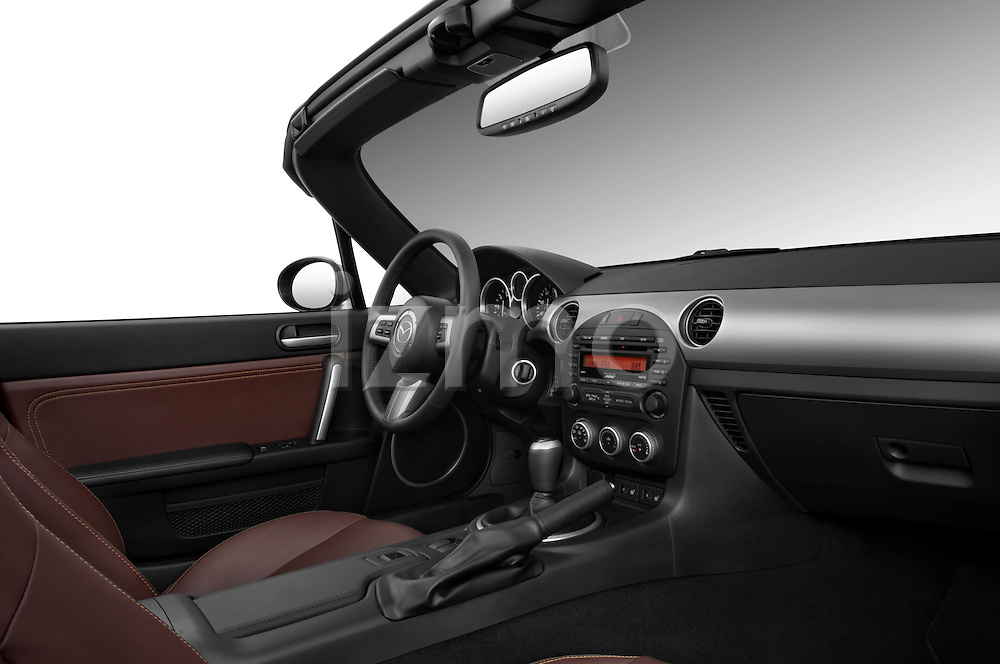 Passenger side dashboard view of a 2010 Mazda Miata MX5.