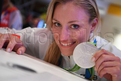 14.08.2016. Rio de Janeiro, Brazil. Tennis player Angelique Kerber of Germany shows her silver medal at the Deutsche Haus (German House) in Barra during the Rio 2016 Olympic Games in Rio de Janeiro, Brazil, 14 August 2016.