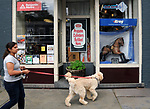 """A view of """"Chester"""" created by, Cody Bisignano, in window of the former Smith Hardware shop at 223 Main Street, one of the """"Rockin' Around Saugerties"""" theme Statues on display throughout the Village of Saugerties, NY, on Friday, June 9, 2017. Photo by Jim Peppler. Copyright/Jim Peppler-2017."""
