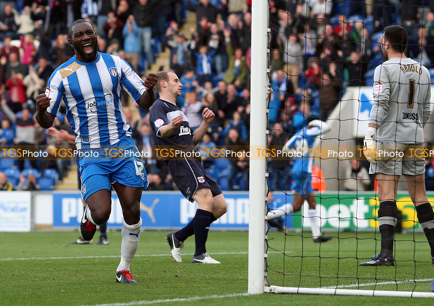 Jabo Ibehre celebrates after Sanchez Watt (background) had just scored the 1st goal for Colchester - Colchester United vs Stevenage, nPower League 1 at The Weston Homes Community Stadium - 13/10/12 - MANDATORY CREDIT: Rob Newell/TGSPHOTO - Self billing applies where appropriate - 0845 094 6026 - contact@tgsphoto.co.uk - NO UNPAID USE.