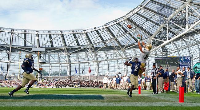 Sep. 1, 2012; Tyler Eifert attempts a catch in the 2012 Shamrock Classic at Aviva Stadium in Dublin, Ireland...Photo by Matt Cashore/University of Notre Dame