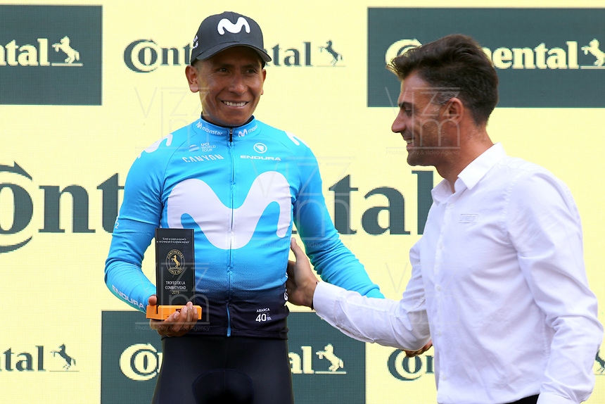 ESPAÑA, 11-09-2019: Nairo Quintana (COL - MOVISTAR) celebra con el premio a la combatividad después de la etapa 17, hoy, 11 de septiembre de 2019, que se corrió entre Aranda de Duero y Guadalajara con una distancia de 219,6 km como parte de La Vuelta a España 2019 que se disputa entre el 24/08 y el 15/09/2019 en territorio español. / Nairo Quintana (COL - MOVISTAR) celebrates with the most combative rider award after stage 17 today, September 11, 2019, from Aranda de Duero to Guadalajara with a distance of 219,6,5 km as part of Tour of Spain 2019 which takes place between 08/24 and 09/15/2019 in Spain.  Photo: VizzorImage / Luis Angel Gomez / ASO<br /> VizzorImage PROVIDES THE ACCESS TO THIS PHOTOGRAPH ONLY AS A PRESS AND EDITORIAL SERVICE AND NOT IS THE OWNER OF COPYRIGHT; ANOTHER USE HAVE ADDITIONAL PERMITS AND IS  REPONSABILITY OF THE END USER
