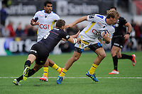 Aurélien Rougerie of ASM Clermont Auvergne evades the tackle attempt of Richard Wigglesworth of Saracens during the European Rugby Champions Cup  Round 1 match between Saracens and ASM Clermont Auvergne at the Twickenham Stoop on Saturday 18th October 2014 (Photo by Rob Munro)