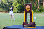 HOWEY IN THE HILLS, FL - MAY 11: The DIII Women's Golf National Championship Trophy with golfer teeing off behind it. The Claremont Mudd Scripps wins the team and individual (Margaret Loncki) First Place Championships during the Division III Women's Golf Championship held at the Mission Inn Resort & Club on May 11, 2018 in Howey-In-The-Hills, Florida. (Photo by Matt Marriott/NCAA Photos via Getty Images)